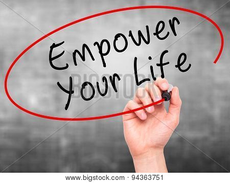 Man Hand writing Empower your Life with black marker on visual screen.