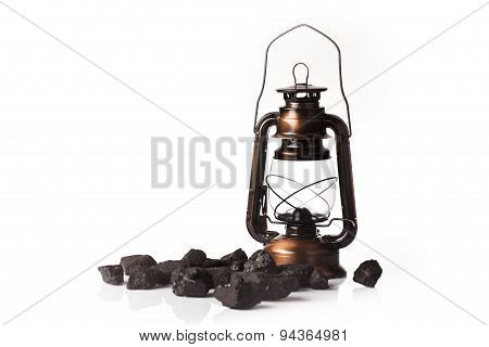 heap of coal and mining tools