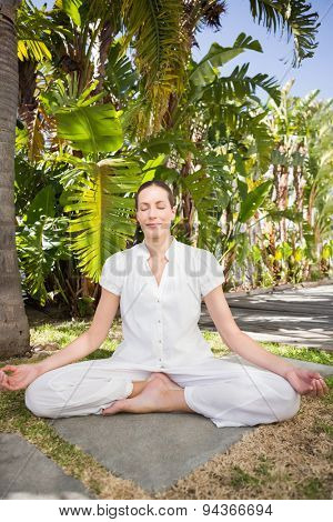 A young woman doing yoga over white backgroung