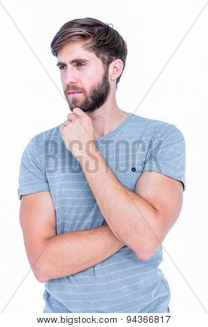 Handsome man thinking with finger on chin on white background