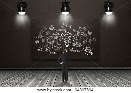 Businesswoman standing and thinking against blackboard