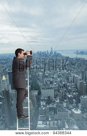 Businessman standing on ladder against new york
