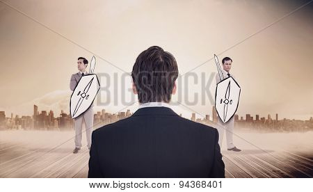 Rear view of businessman standing against large city on the horizon
