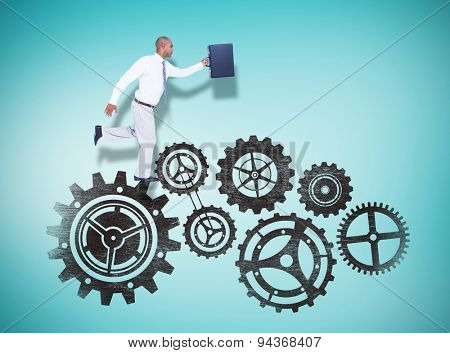 Businessman running with briefcase against blue vignette background
