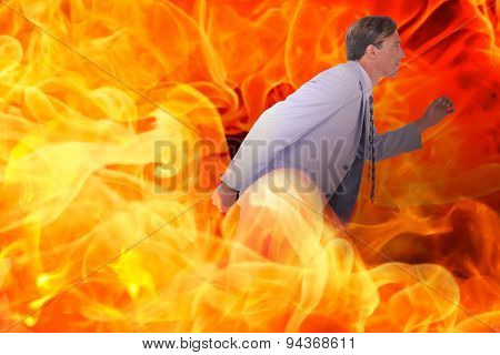 Stepping businessman against fire