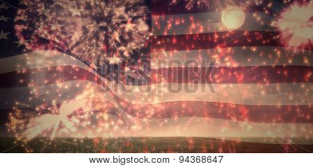 Digitally generated united states national flag against colourful fireworks exploding on black background