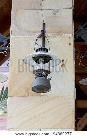 Close Up Lantern Hanging On Hook On Marble Pillar