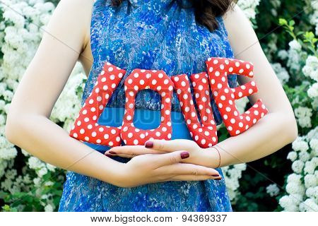 The Girl In A Blue Dress Holding A Textile Fabric Letters - The Word Love