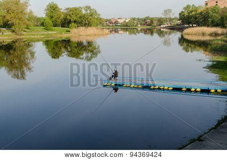 Fisherman at river
