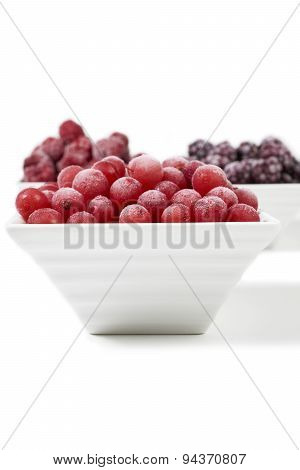 Bowls With Frozen Berries On White Background