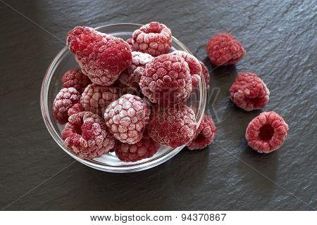 Frozen Raspberries In A Glass Bowl