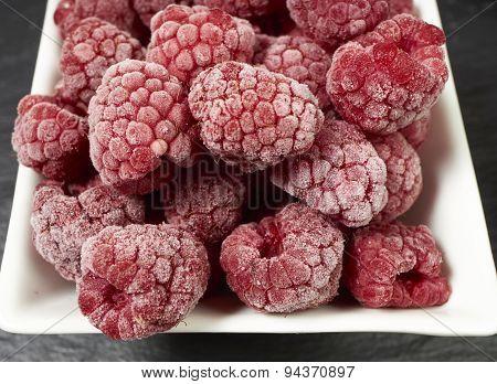 Frozen Raspberries In A Porcelain Dish