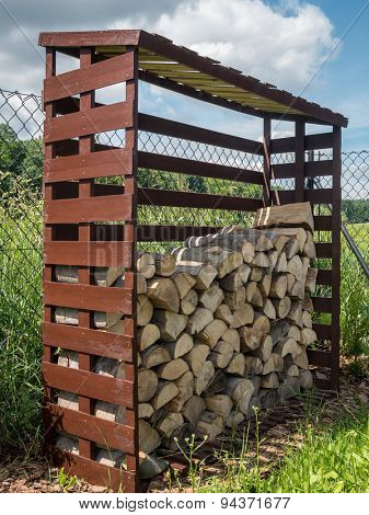 Woodshed with arranged chopped firewood