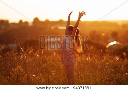 Happy Girl In A Field On Summer Evening