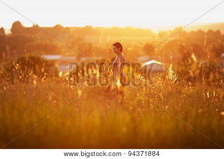 Happy Woman Walking On The Field