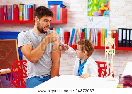 Family Playing In Doctor And Patient, Father Scared Of Injection