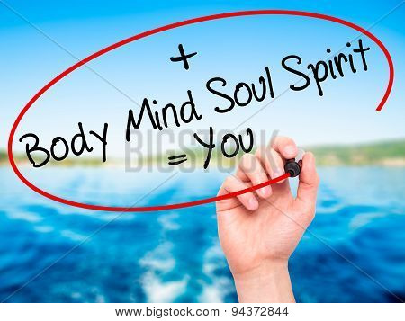 Man Hand writing Body + Mind + Soul + Spirit = You with black marker on visual screen.