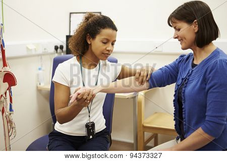 Female Patient Having Physiotherapy In Hospital