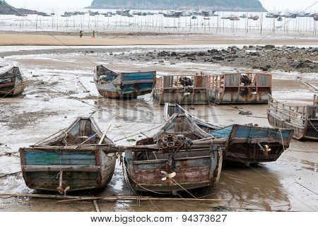 old fishing boats at a fishermen's village by the sea