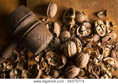 Hammer And Cracked Walnuts