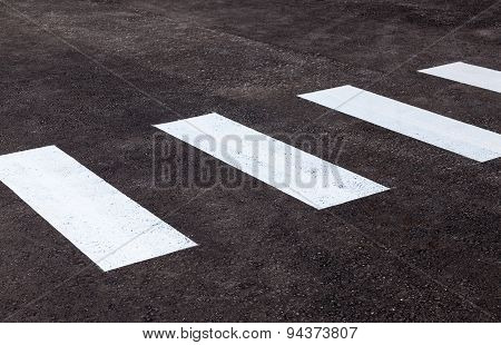 Zebra Crossing With White Marking Lines On Asphalt