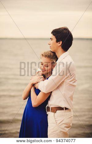 Couple Embraces On The Lake