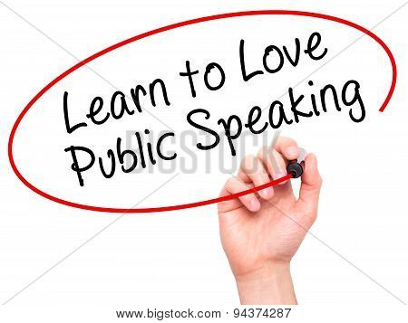 Man Hand writing Learn to Love Public Speaking with black marker on visual screen.
