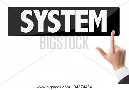 Businessman pressing button with the text: System