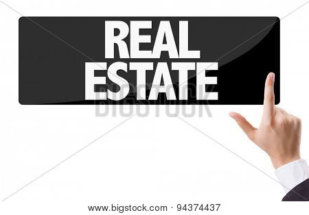 Businessman pressing button with the text: Real Estate