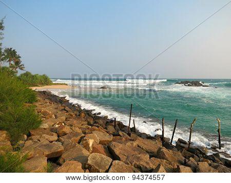 Fishermen's sticks at ocean coast in Sri-Lanka