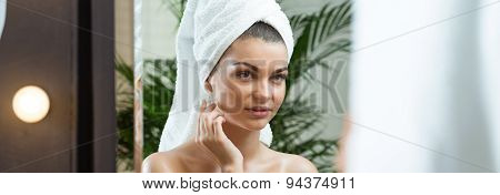 Woman Is Looking At Herself