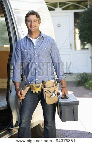 Portrait Of Repairman Arriving In Van