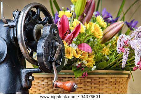 Flower arrangement with sewing-machine on a table