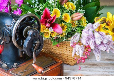 Old sewing machine and flowers
