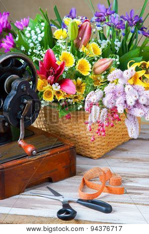 Old black sewing machine and flowers