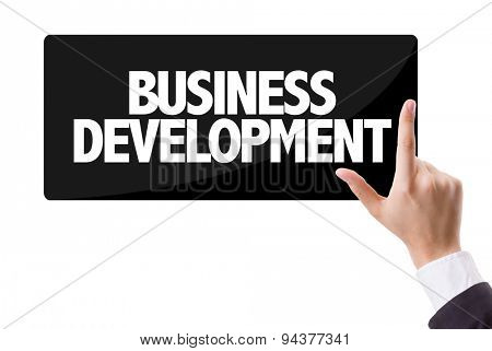 Businessman pressing button with the text: Business Development