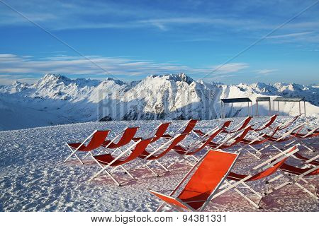 Chairs on the slopes of the mountains in the Alps
