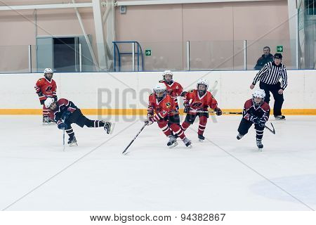 Game moment of children ice-hockey teams