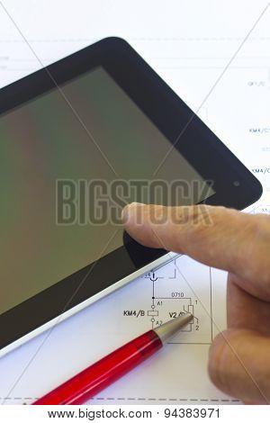 Tablet computer over engineering diagram