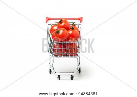 shopping cart with cherry tomatoes, isolated on white background