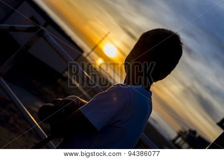 Boy Looking At Sunset
