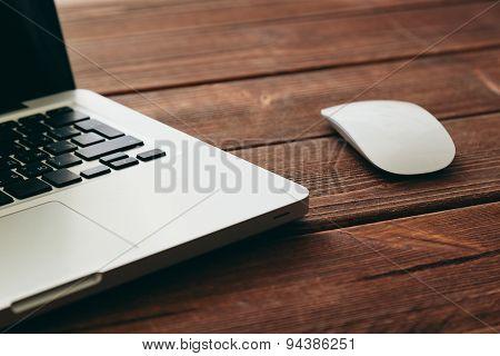Close-up shot of laptop on old wooden desk