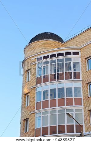 Dome Roof And Balconies In Apartment Building Of Yellow Brick