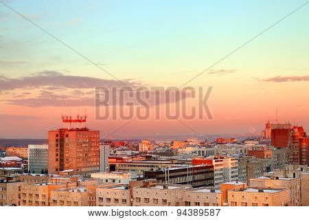 Buildings Evening City Against Beautiful Sky And Red Horizon