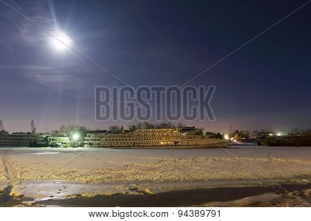 Passenger Ships In Frozen River Covered With Snow At Night And Beautiful Sky