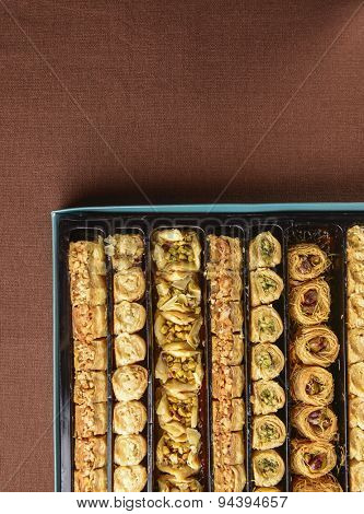 Assorted turkish sweet- baklava in a gift pack. View from top.