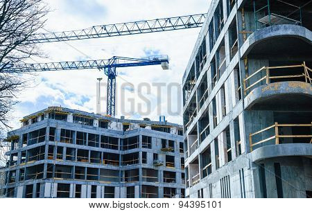 Building Construction And Crane On Sky Background