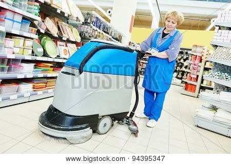 Floor cleaning services with washing machine in supermarket shop store