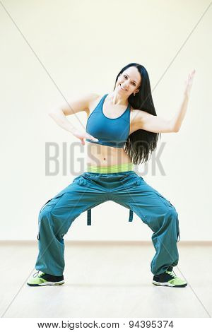 fitness instructor doing dancing exercises in sport club