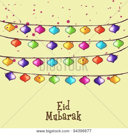 Beautiful greeting card decorated with colorful lights for famous festival of Muslim community, Eid Mubarak celebration.